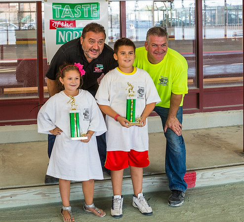 Kids bocce trophy winners with TONE Bocce Chairs Donato Frattaroli and Chris Zizza