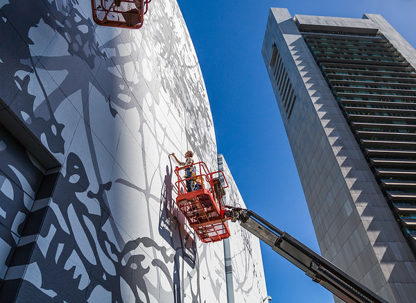 Artist Matthew Richie puts the finishing touches on Remanence - Salt and Light (Part II) on the Greenway mural