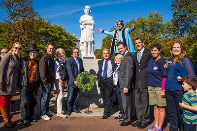Community leaders lay wreath at statue of Christopher Columbus