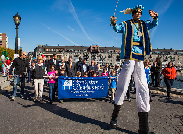 Columbus on stilts leads the parade in the park