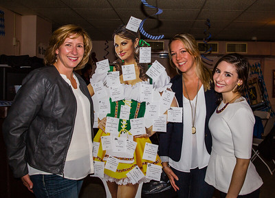 NEMPAC Board President Susan Ward (left) with Executive Director Sherri Snow and Rebecca Raboport-Cole (right) and the Oktoberfest beer stein girl