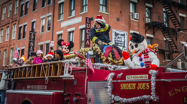 On the fire truck in the North End Christmas Parade