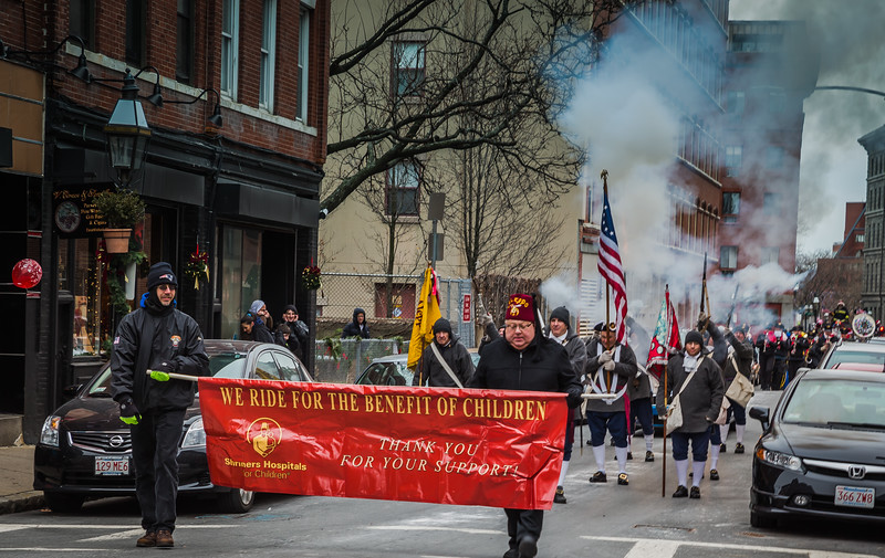 Shriners Hospitals in the Christmas Parade with smoke from the Colonial guns