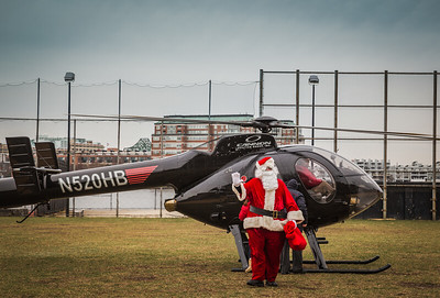 Santa Claus arrives via helicopter at the North End Park