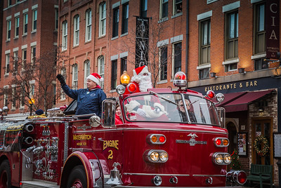 John Romano with Santa on Engine 2 in the North End Christmas Parade