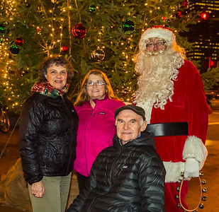 Patricia and Tip Thibouot with Adrianna DeStefano and Santa Claus!