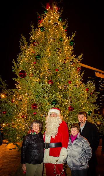 (L-R) Patricia Thiboutot, Santa Claus, Alison Seavey and David Grant