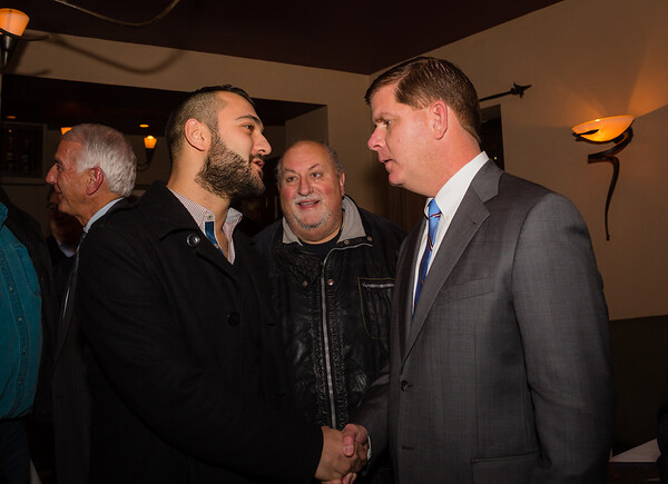Malaz Hayek (left) speaks with Boston Mayor-Elect Marty Walsh.CR2