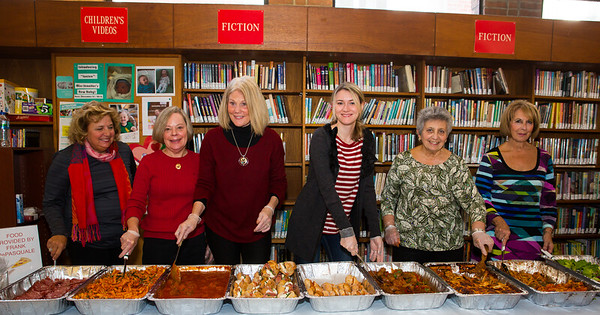 Friends serve food at the Open House, courtesy of Frank DePasquale