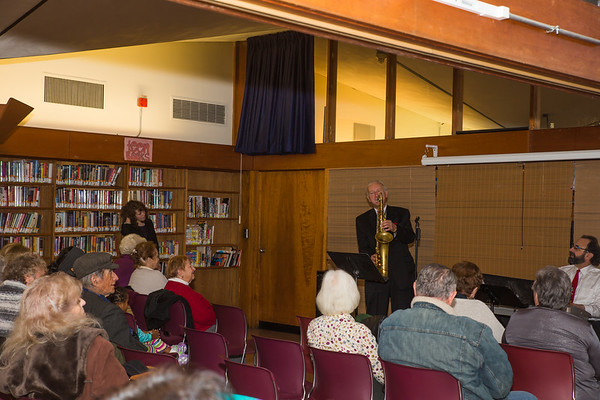 A crowd gathers at the North End Branch Library for a performance