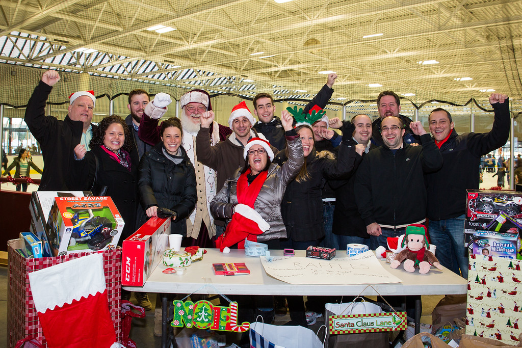 Cheering Columbus Day Celebration Committee and Organizers of the Santa Skate and Toy Drive