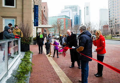 Boston Harbor Hotel General Manager Jonathan Crellin cuts the grand opening rink ribbon