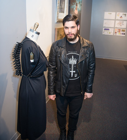 KCAD student Oscar Fierro with his piece Vertebrae & Asymmetrical Draped Dress.