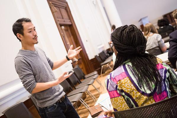 Churu Yun speaking with student.