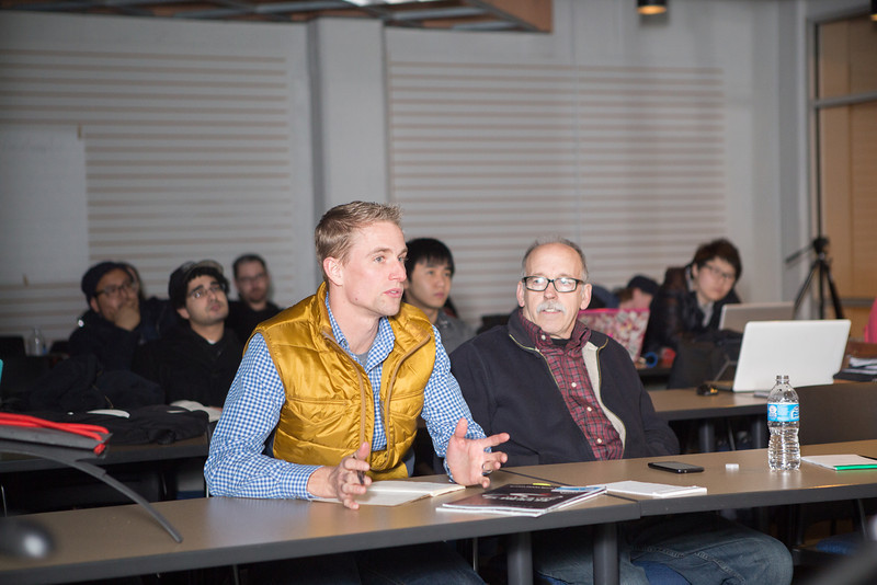 Mark Groendal, owner and inventor of Alter Cycles and Tim Stoepker, consultant designer and alumnus, give feedback to students.