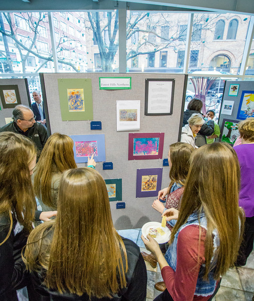 Guests looking at art created by Forest Hillls Northern students.