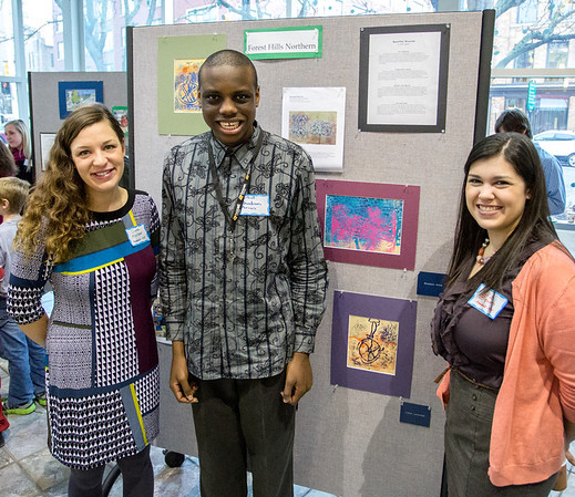 KCAD student teachers Gabe Mulder (left) and Liz Brown (right) with Rhodson Arius (middle, the Forest Hills Northern student they worked with).