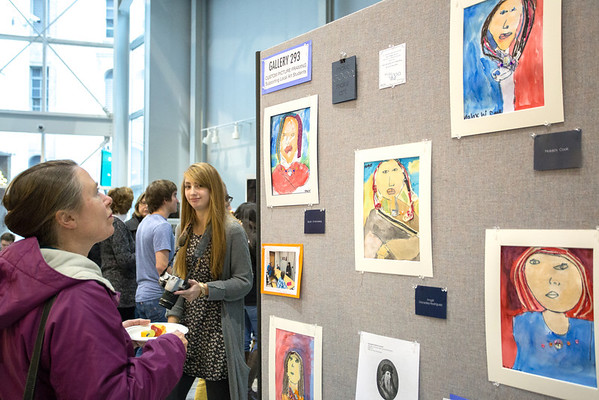 Guests looking at student art.