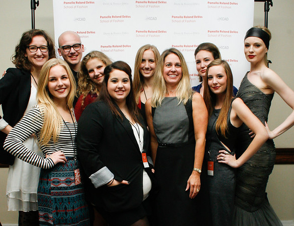Lori Faulkner (4th from right, Chair of the Fashion Studies Program), Valeriya (1st on right, a model from New York City wearing a design of Pamella), and Fashion Studies students.