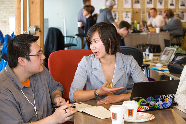 Philip Han (left, KCAD) and Aziza Ahmad (right, GVSU) collaborate at Startup Weekend GR.