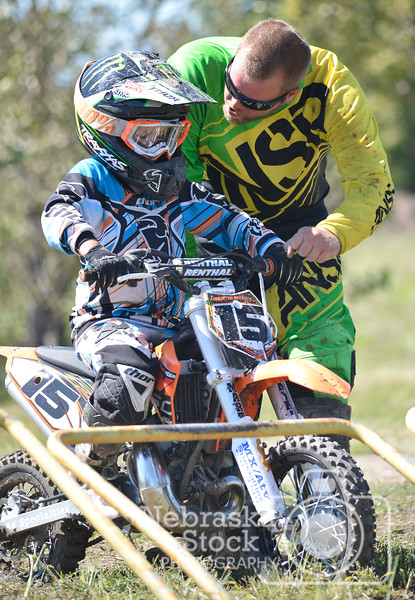 Norfolkan Jon Myrick, gives his son Martin Myrick last minute instruction before the gate drops in his 50cc Jr moto Sunday during the 8th round of the Nebraska State Motocross Series out at the Off Road Ranch. <br /> Photo by Aaron Beckman