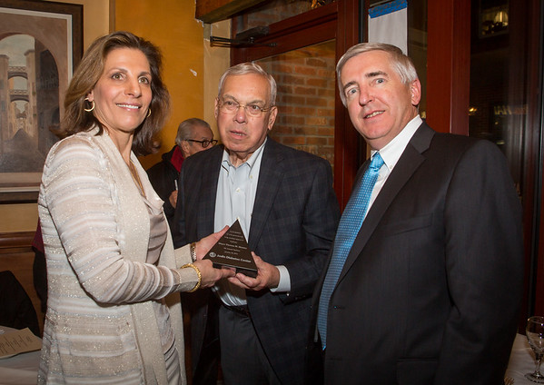 Carla Agrippino Gomes (left) and John L. Brooks, III (right) present Mayor Thomas M. Menino with an award recognizing his longtime support.