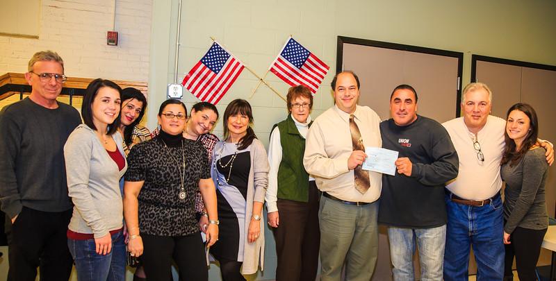 2014-01 | ROC Teen Saturday Presents Donation to NEAD