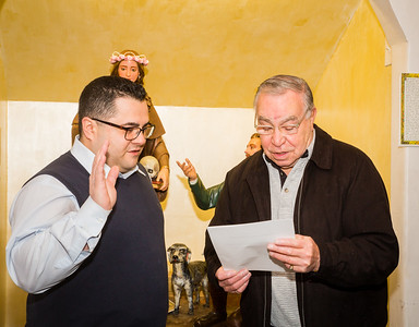 Danny Puccio (left) being sworn in as new President by Sr. Member Frank Longo of the Santa Rosalia di Palermo Society