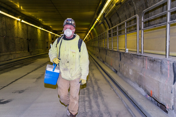 Worker after shift inside tunnel