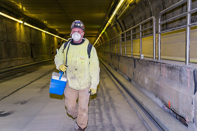 Worker after shift inside tunnel