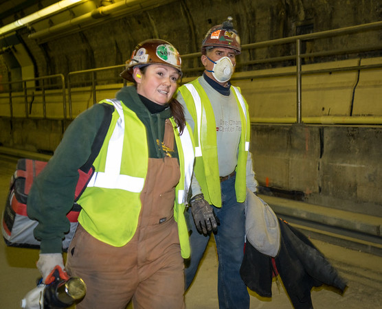 Workers leaving a shift inside the Callahan Tunnel