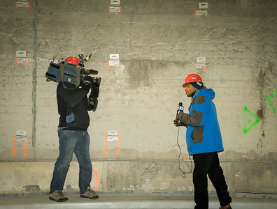 Reporters tape a broadcase withthe newly reinforced side panel brackets shown on the wall