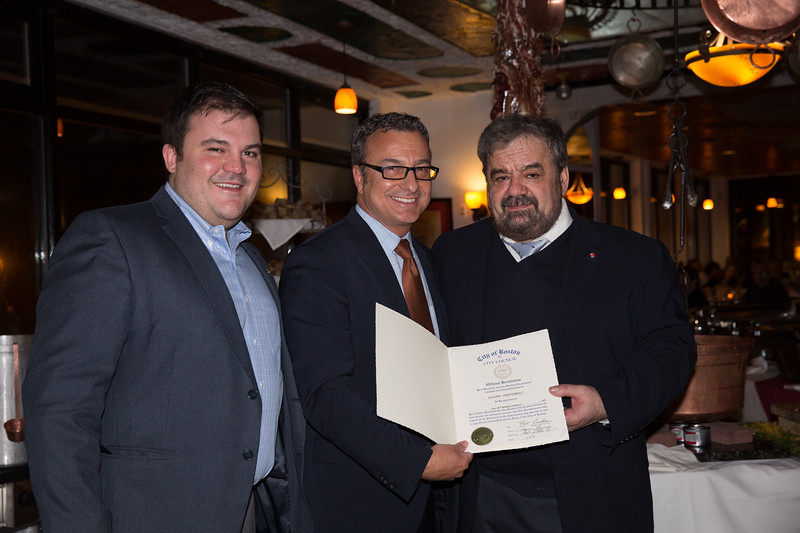 Boston City Councilor Sal LaMattina (center) presents a City Council Recognition Award to Cav. Filippo Frattaroli (right) with son Philip (left)