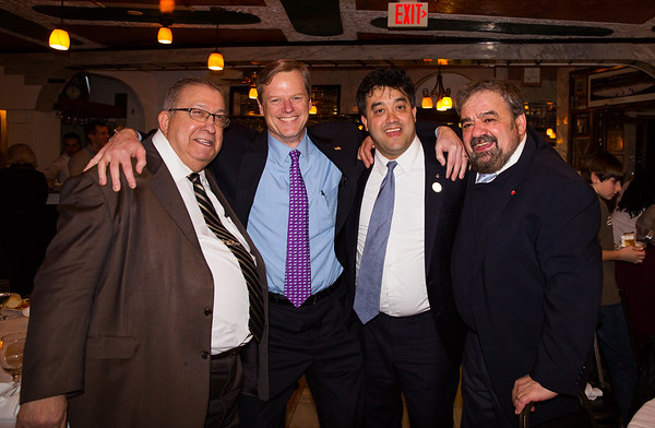 Gubernatorial candidate Charlie Baker (2nd from left) crouches down in this photo with Frank Privitera (left), Phil Privitera (2nd from right) and Cav. Filippo Frattaroli (right).