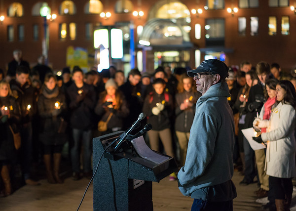 Keith Munsell speaking at the vigil for his son, Eric