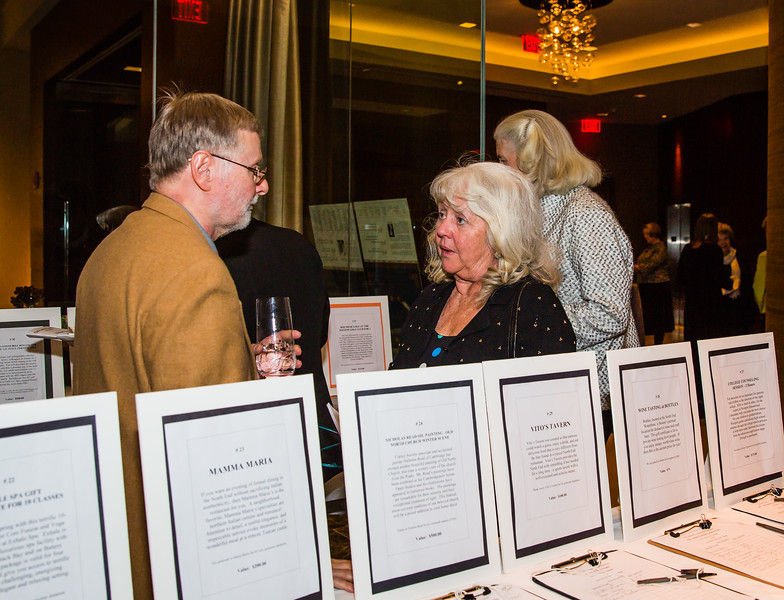 Dozens of silent auction items garnered much activity to raise funds