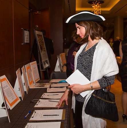 Asst. Vicar at Old North Church, Ellie Terry, peruses the auction items with a patriot cap