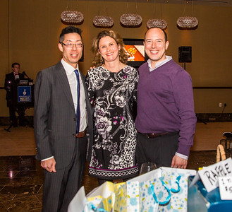 In charge of the raffle, Tk Vu, Meredith Stewart and Matthew Nevill