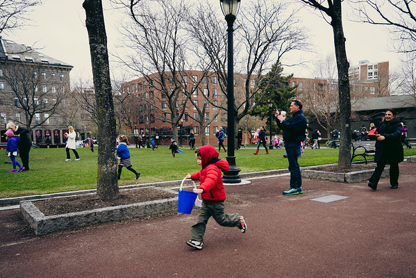 A boy runs at the start of 2014 Egg Hunt at Christopher Columbus Park