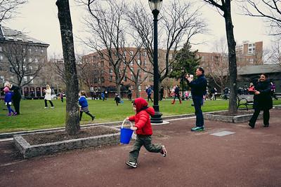 A boy runs at the start of 2014 Egg Hunt at Christopher Columbus Park