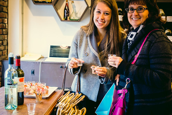 Customers nibble (from Panza) and sip at The Wine Bottega