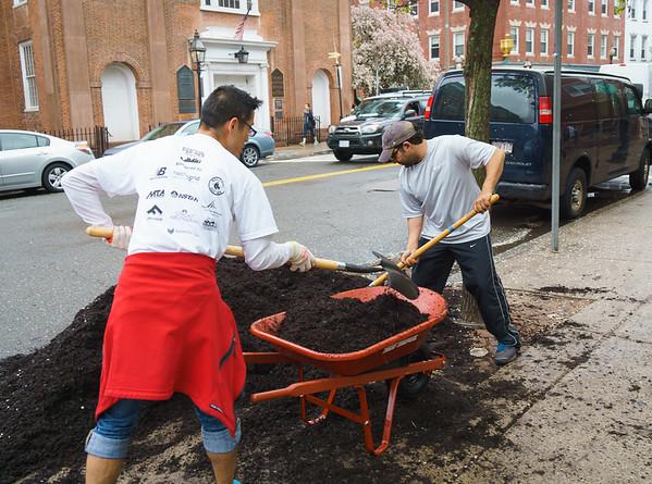 Volunteers transport potting soil