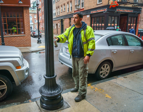 Public Works crews were out sprucing up paint on the lamposts