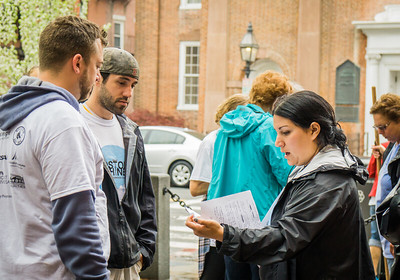 North End Neighborhood Coordinator, Nicole Leo, gives out assignments to volunteers
