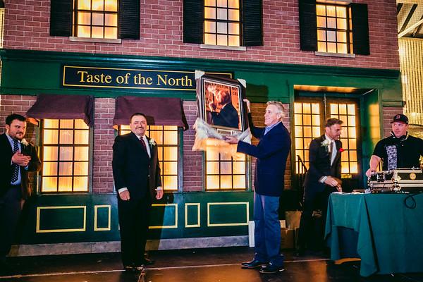 TONE Founder Donato Frattaroli presents a gift of appreciation to Host Billy Costa