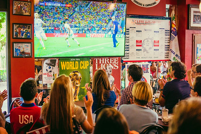 Cheering crowd at Caffe dello Sport