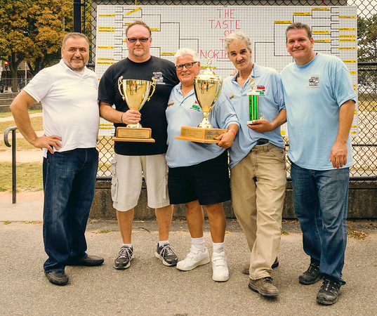 Organizers Donato Frattaroli and Chris Zizza congratulate first place winners Natalae and Johnny with winning sponsor Piantedosi
