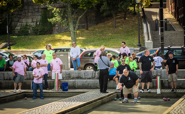 Pink and black teams play bocce