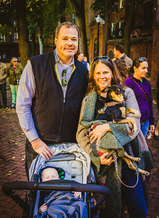 Chad and Kathryn with dog and baby on the Prado for the Blessing of the Animals
