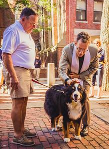 Rev. Steve blesses a dog on the Prado